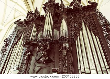 Famous pipe organ in Church of St. James Brno Moravia Czech republic. Musical instrument. Religious architecture. Old photo filter.
