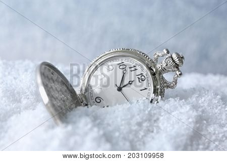Watch on snow, close up. Christmas countdown concept
