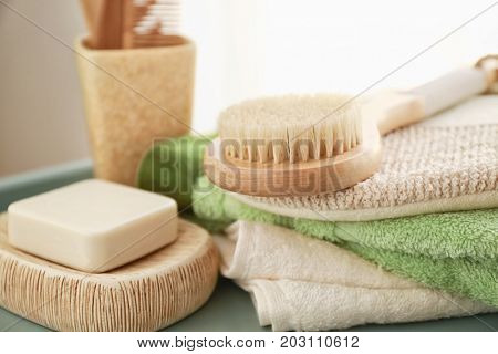 Composition with bath accessories and soap on table
