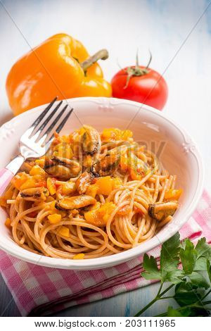 pasta with mussel capsicum and tomato sauce, selective focus