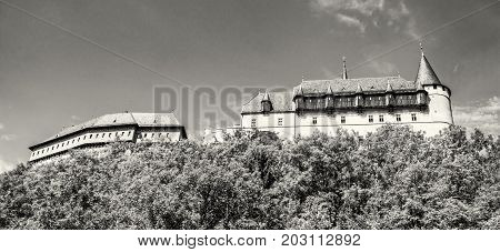 Gothic castle Karlstejn in Czech republic. Ancient architecture. Travel destination. Side view. Black and white photo.