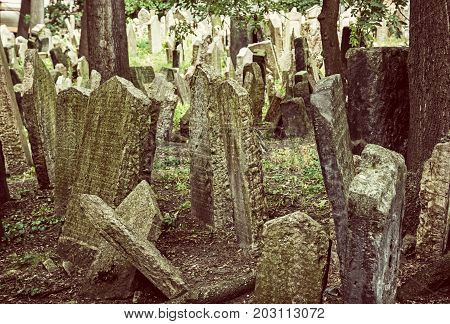 Jewish cemetery in Prague Czech republic. Memorial place. Many graves. Historical object. Old photo filter.