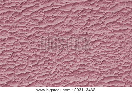 Pink roughened bumpy texture background. Pink pattern.