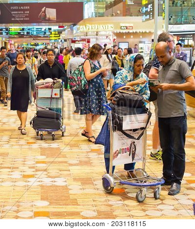 Crowded  Changi Airport Hall. Singapore