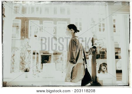 Vintage Black And White Photo Of Woman Standing Inside Shop At Storefront