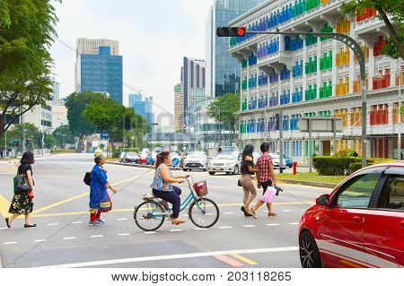 People Crossing A Road. Singapore