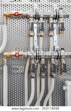 System of steel pipelines and regulators. Plactic curved tubes, brass connectors and valves.