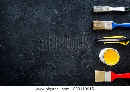 set of tools for build, paint and repair house on dark desk background top view mock-up
