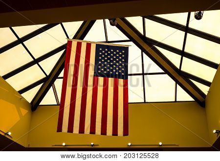 An American Flag hanging from the skylights in a local building.