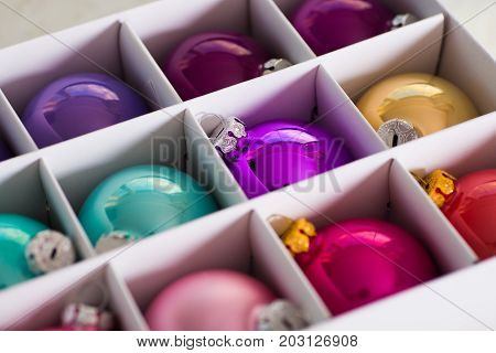 Many Beautiful Colorful Christmas Balls In White Box