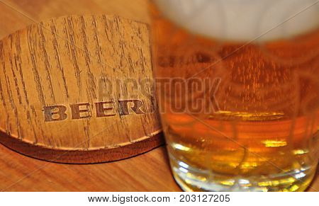 Coaster and cold beer in close up