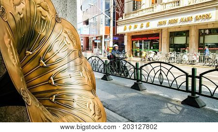 Shanghai, China - Nov 6, 2016: On Nanjing Road Pedestrian Street - The prominent Modern Lady cosmetic store featuring the trumpet of a classical gramophone in the foreground overlooking the street.