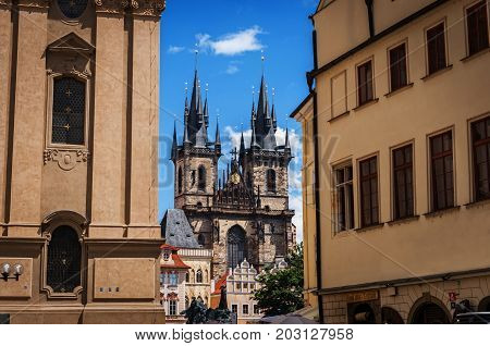 Old Town of Prague, Czech Republic. View on Tyn Church and Jan Hus Memorial on the square as seen from Old Town City Hall. Blue sunny sky.