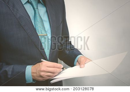 Business man signing documents. Contract or agreement conclusion.
