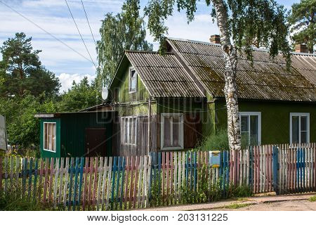 A typical residential wooden house in settlement of city type in Leningrad region, Russia.