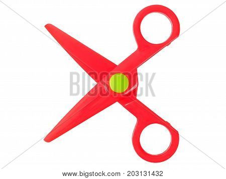 Small plastic red scissors isolated on white background.