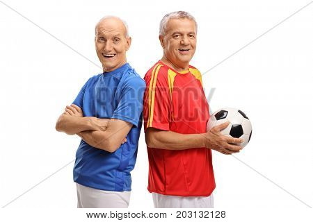 Two elderly soccer players looking at the camera and smiling isolated on white background