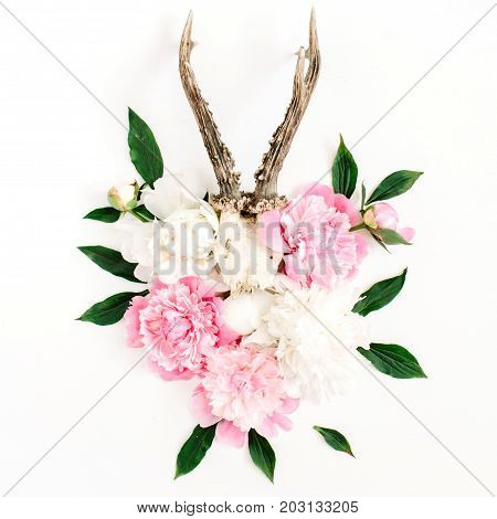 Beautiful pink and white peony flowers bouquet and goat horns on white background. Flat lay top view modern stylish hipster background.