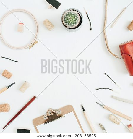 Layout with copy space made of retro camera succulent tools for handmade arts clipboard on white background. Top view flat lay hipster artist concept.