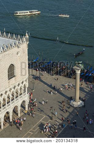 VENICE, ITALY - JUNE 15: Saint Mark Square and Venice Lagoon with tourists monuments and gondola seen from above JUNE 15, 2017 in Venice, Italy