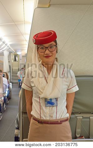 DUBAI - NOVEMBER 17, 2015: Emirates cabin crew attendant on board of Airbus A380.
