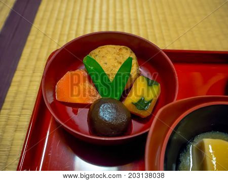 Close up of a lunch served in a red plates, in a restaurant in Japan.