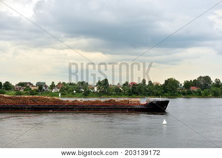 Cargo ship on the Neva river in outskirts of St.Petersburg Russia.