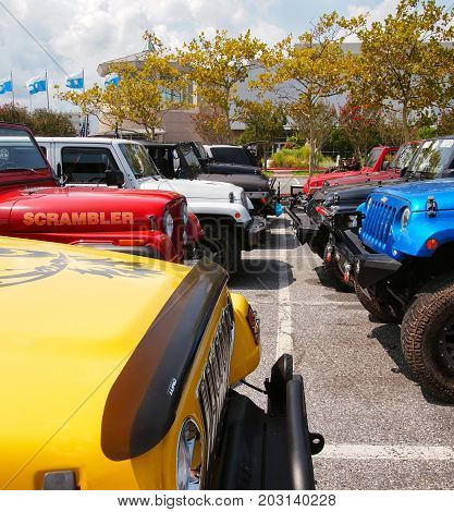 OCEAN CITY MD - AUGUST 26 2017: Two rows of Jeeps parked grill to grill in the convention center parking lot at Jeep Week in Ocean City MD.