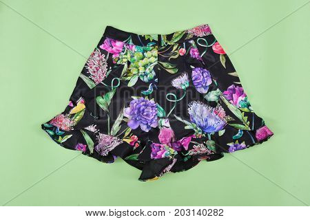 floral skirt isolated-green background