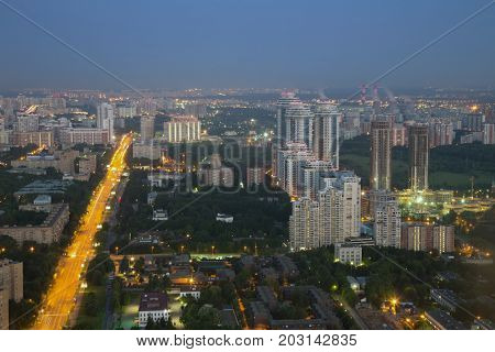Residential area with buidlings, road in Moscow, Russia at summer night