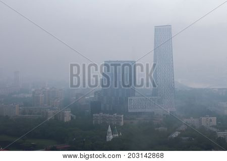 Skyscrapers on Mosfilmovskaya street in fog at morning in Moscow, Russia