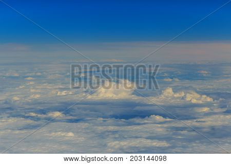 clouds from the altitude of the plane Blue perfect sky sea of clouds from high altitude space background.