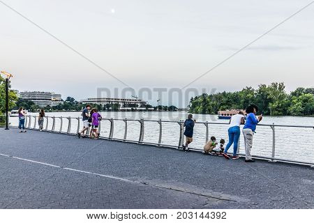 Washington Dc, Usa - August 4, 2017: People In Georgetown Park On Riverfront In Evening With Potomac
