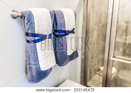 Staging Modern Bathroom With Two Decorated Towels Hanging On Rack By Shower In Model Home, Apartment