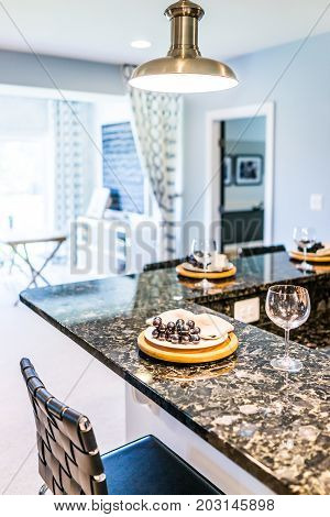Grapes On Plate Of Modern Granite Kitchen Bar In Luxury Apartment, Home Or House Model