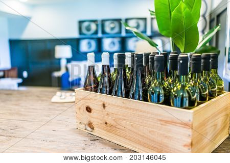 Closeup Of Wooden Crate Of Wine Bottles On Table In Room In Home, House Or Apartment