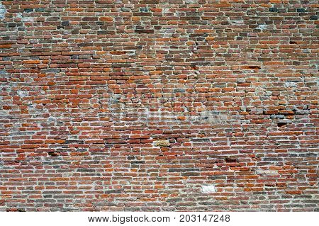 Old weathered red brick wall background