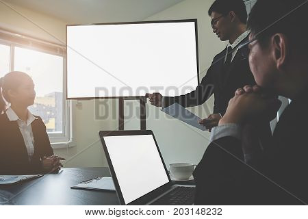 Business women making a presentation with whiteboard. Business executive delivering a presentation to his colleagues during meeting or in-house business training.