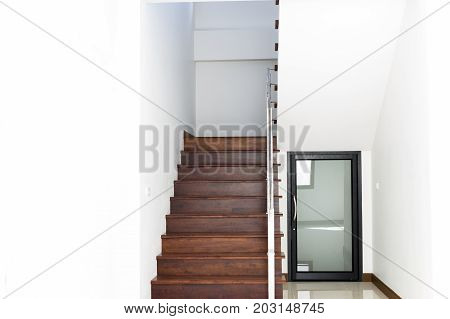 interior design staircase concrete top wooden stainless steel railing in the home