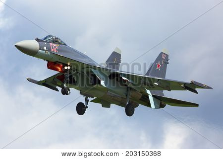 Kubinka, Moscow Region, Russia - June 9, 2015: Sukhoi SU-35S RF-95243 modern superconic jet fighter of russian air force landing at Kubinka air force base during Army-2015 forum