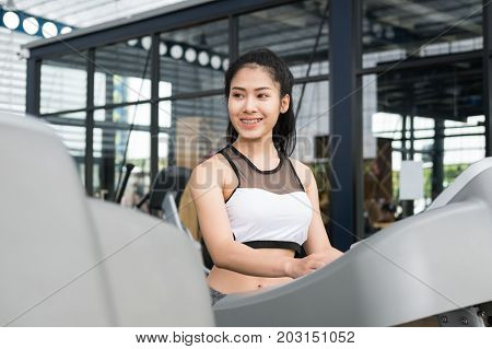 Young Woman Execute Exercise In Fitness Center. Female Athlete Walking On Treadmill In Gym. Sporty G