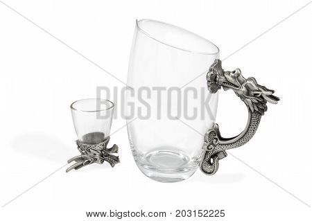 Art set of decanter and wine glasses for vodka with a handle and a bottom in the form of a dragon, isolated on a white background