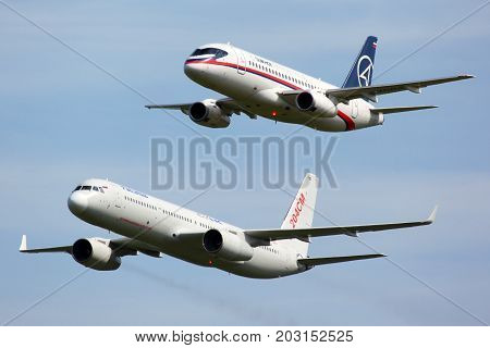 Zhukovsky, Moscow Region, Russia - August 12, 2011: Sukhoi Superjet 100 97004 shown together with Tupolev Tu-204SM 64150 at MAKS-2011 airshow in Zhukovsky
