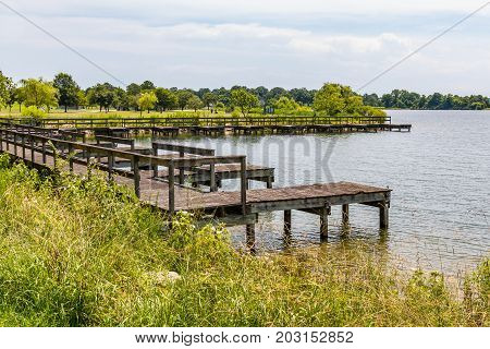 The boat dock at Mount Trashmore Park, a city park in Virginia Beach, Virginia created on the site of a former landfill.  It has two man-made mountains, the lake, walking trails, and picnic areas.
