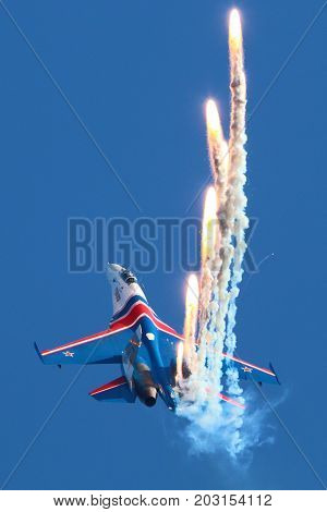 Zhukovsky, Moscow Region, Russia - August 28, 2015: Sukhoi Su-27 of Russian Knights aerobatics team perfoming demonstration flight in Zhukovsky during MAKS-2015 airshow.