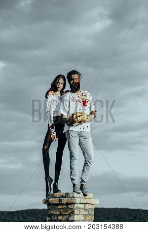 Halloween Couple Standing On Chimney