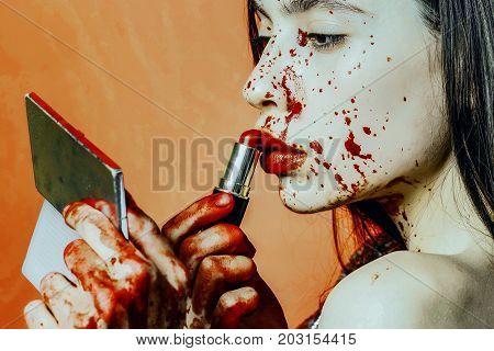 Halloween Girl Applying Red Lipstick Makeup