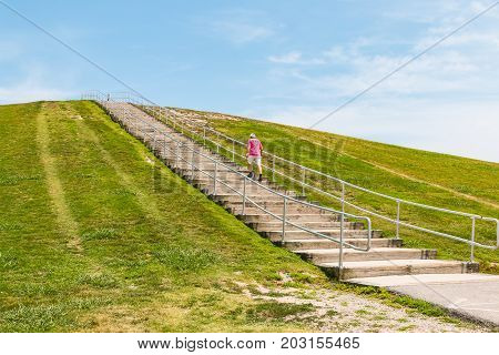 VIRGINIA BEACH, VIRGINIA - JULY 10, 2017:  A man exercises on the popular stairway to the top of Mount Trashmore, the site of a former landfill which was converted to a city park in 1974.