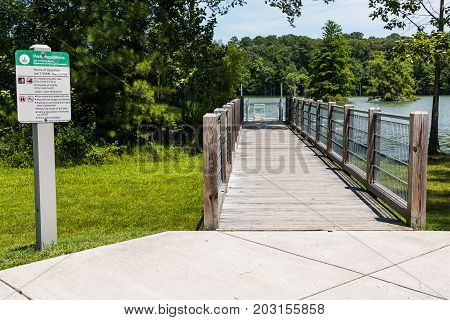 VIRGINIA BEACH, VIRGINIA - JULY 10, 2017:  The ramp leading to the ADA-compliant kayak/canoe launch at Stumpy Lake Natural Area which opened in November 2011.