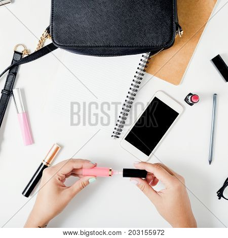 Freelancer feminine workspace in flat lay style with female accessories. Top view